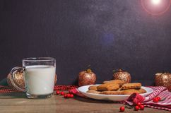 Biscuits and milk on a red napkin in Christmas decor with free space. For text Royalty Free Stock Images