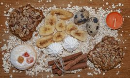 Biscuits oats flakes cinnamon sticks on a wooden table royalty free stock photo