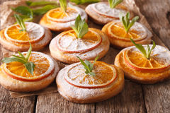 Biscuits with orange slices and mint close-up on the table. hori Royalty Free Stock Image