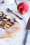 Biscuits with peach and blueberry. On a white table Stock Photos