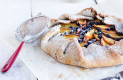 Biscuits with peach and blueberry. On a white table Royalty Free Stock Photo