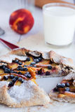 Biscuits with peach and blueberry on a white table. With a glass of milk Royalty Free Stock Photography