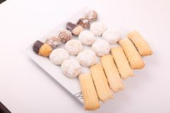 Biscuits, petits fours and cakes. Cakes, biscuits, candies and petits fours presented in a dish Stock Photo