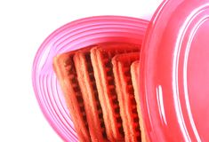 Biscuits in a  pink snack plastic box with cap. Stock Photos
