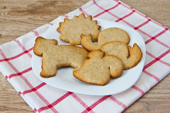 Biscuits on a plate. Biscuits in the form of figures animal on a plate Royalty Free Stock Image