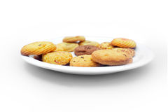 Biscuits in plate. Isolated on white background Royalty Free Stock Photo