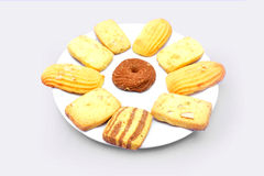 Biscuits in plate. Isolated on white background Stock Photography