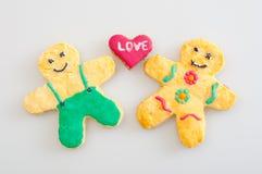 Biscuits représentant l'amour entre l'homme et les femmes Photos stock