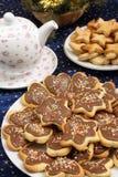 Biscuits sablés avec le glaçage de chocolat Photographie stock