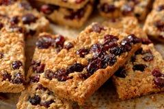 Biscuits sablés de sésame avec des canneberges Photographie stock