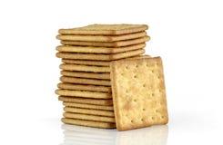 Biscuits salés d'isolement sur le fond blanc Photographie stock