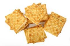 Biscuits salés sur le blanc Photos libres de droits