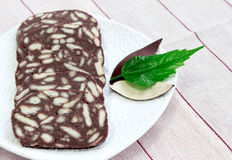 Biscuits salami with cocoa and butter. Delicious biscuits salami with cocoa and butter Stock Photo