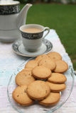 Biscuits served with tea pot and a cup Royalty Free Stock Image