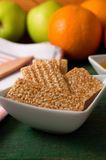 Biscuits from sesame seeds and honey in square bowl Royalty Free Stock Images