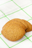 Biscuits in the shape of a lemon on a kitchen tablecloth Royalty Free Stock Photography
