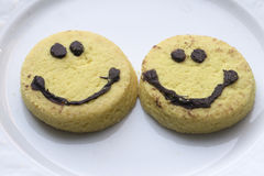 Biscuits souriants de visage Photographie stock libre de droits
