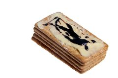 Biscuits stacked. Neatly with butter and marmite isolated on white royalty free stock photos