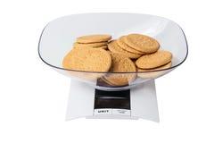 Biscuits sur des échelles Photographie stock libre de droits