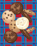 Biscuits sur le tartan Photographie stock