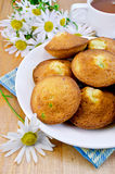 Biscuits with tea and camomiles Stock Photos