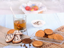 Biscuits with tea and sweets. For Breakfast and apples in the basket Royalty Free Stock Photography