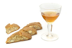 Biscuits And Vin Santo. Typical italian sweets and wine isolated over white background Stock Photo