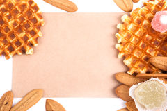 Biscuits, waffles, fruit jelly  on white background with space for text on the envelope Stock Photos