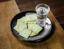 Biscuits with water drink stock images