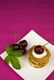Biscuits with whipped cream and cherry Royalty Free Stock Image