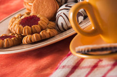 Biscuits wit cup of tea with decoration Stock Photos