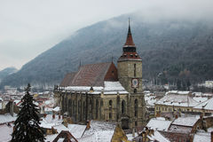 Biserica Neagra din Brasov - The Black Church in Brasov. Picture showing Brasovs most important landmark, the Black Church, on a cloudy winter day. It is the royalty free stock image