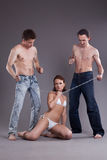 Bisexual men and women with chain Stock Images