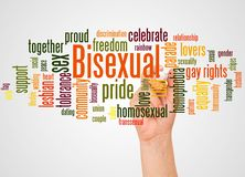 Bisexual word cloud and hand with marker concept. On white background royalty free stock photography