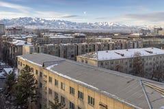 Bishkek against the background of snowy winter mountains. Kyrgyzstan. Bishkek city against the background of snowy mountains royalty free stock image