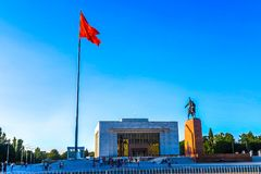 Bishkek Ala Too Square 01. Bishkek Ala Too Square Waving Kyrgyz Flag on Flagpole with Hero Manas Statue and State History Museum View Point stock photo