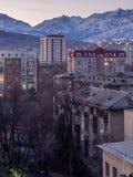 Bishkek city against the background of snowy mountains. Kyrgyzstan. Bishkek city against the background of snowy mountains stock photography