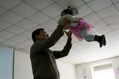 Christmas celebration in the Protestant Church `Renewal`. Father plays with daughter. stock image