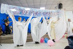 Christmas celebration in the Protestant Church `Renewal`. Girls play angels. royalty free stock photos
