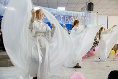 Christmas celebration in the Protestant Church `Renewal`. Girls play angels. royalty free stock image