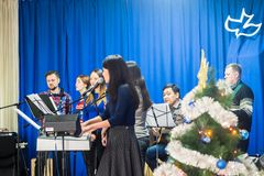 Christmas celebration in the Protestant Church `Renewal`. The parishioners singing Christmas songs. stock photos