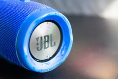 JBL. Bishkek, Kyrgyzstan - February 24, 2018: JBL logo on a blue bluetooth speaker with textile and metalic texture royalty free stock photos