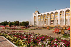 BISHKEK, KYRGYZSTAN: Flowers on the square Ala-Too. People have rest at the square Ala-Too with the flowers at sunny day in Bishkek, Kyrgyzstan. Kyrgyzstan's royalty free stock photography