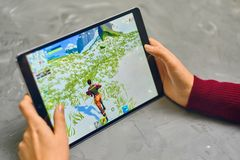 Fortnite Gameplay on ipad. Bishkek, Kyrgyzstan - January 21, 2019: Woman playing fortnite game of epic games company on Apple ios tablet iPad Pro stock photos