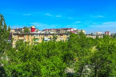 Bishkek Residential Highrises 01. Bishkek Reential Highrises Block with Public Park and Trees Skyline royalty free stock image