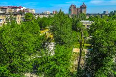 Bishkek Residential Highrises 02. Bishkek Residential Highrises Block with Public Park and Trees Skyline royalty free stock photography