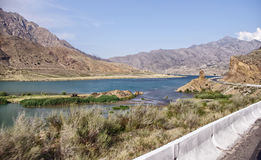Bishkek road - Osh in Kyrgyzstan, Naryn. Famous road Bishkek - Osh in Kyrgyzstan, the road goes along the river Naryn, turquoise river, very beautiful. The road Stock Images