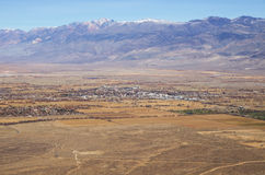Bishop California. The city of Bishop and the White Mountains viewed from above in December royalty free stock images
