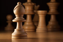 Bishop chess. Photography of white bishop chess on wood table stock photos