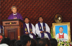 Bishop on holy platform. UBON RATCHATHANI, THAILAND – MAR 19, 2012 : Pontiff Phillip Banchong Chaiyara on the holy platform for the Catholic funeral of priest Royalty Free Stock Image